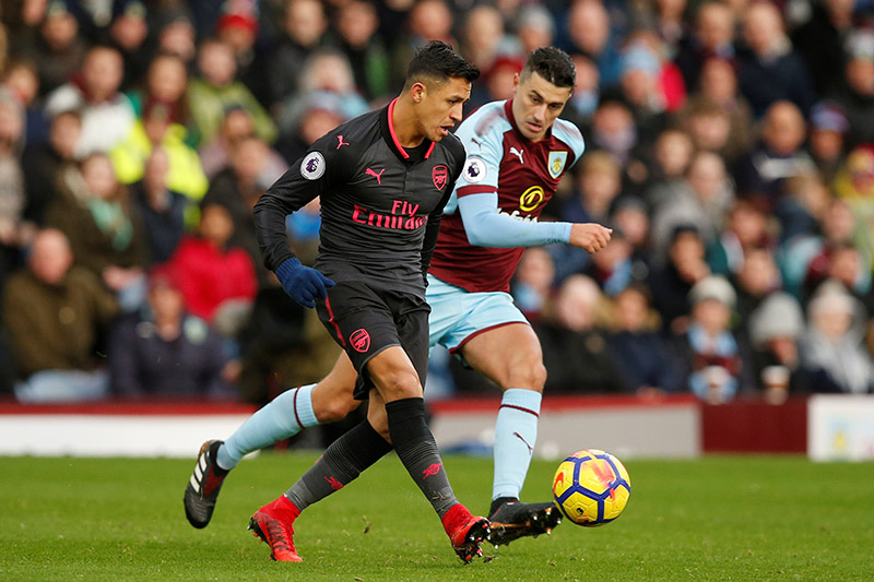 Arsenal's Alexis Sanchez in action with Burnley's Matthew Lowton. Photo: Reuters