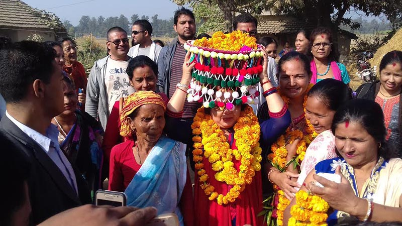 Prime Minister Sher Bahadur Deubau2019s spouse Arzu Rana Deuba carrying traditional basket in Kailali, on Monday, November 13, 2017. Photo: THT