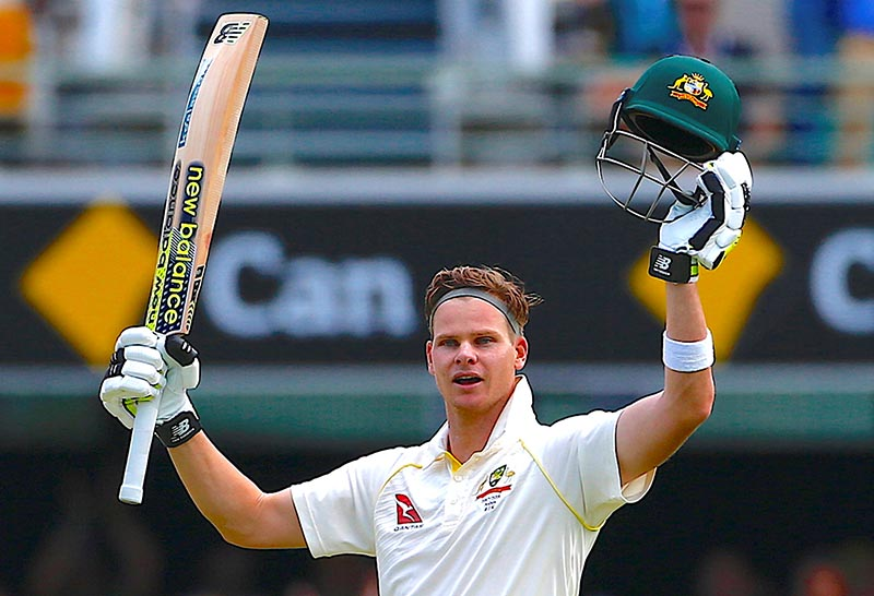 Australia's captain Steve Smith celebrates after reaching his century during the third day of the first Ashes cricket test match between Australia and England, at GABBA Ground, in Brisbane, Australia, on November 25, 2017. Photo: Reuters