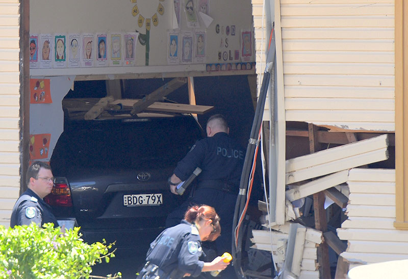 New South Wales emergency services personnel and police inspect a vehicle that crashed into a primary school classroom in the Sydney suburb of Greenacre in Australia, on November 7, 2017. Photo: AAP/Dean Lewins via Reuters
