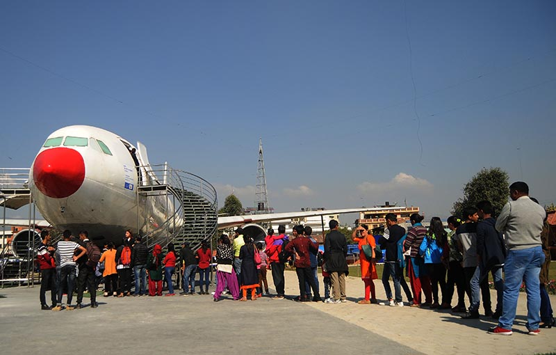 Visitors wait in a queue to visit the Aviation Museum at Sinamamgal, Kathmandu, on Saturday, November11, 2017. Captain Bed Upreti turned the wrecked Turkish Air Airbus-330 into a museum. The cockpit of the craft provides space to showcase various aircraft models since the time of Wright Brothers. Photo: Balkrishna Thapa Chhetri/THT
