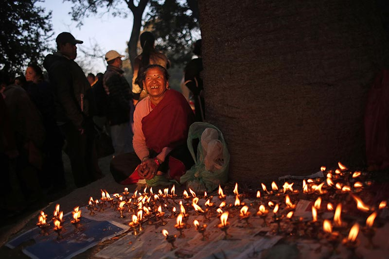 A woman smile as she talks to her friend after lighting oil lamps during Bala Chaturdashi festival in the courtyard of Pashupatinath temple in Kathmandu, on Friday, November 17, 2017. Photo: AP