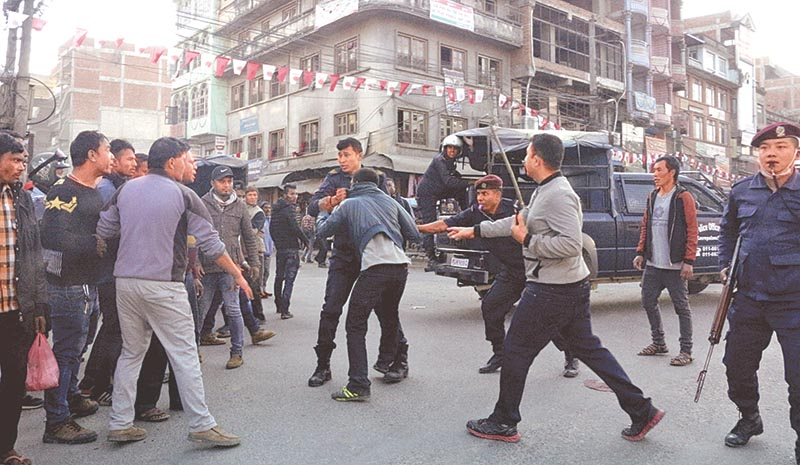 Police taking angry mob under control after a tipper hit a motorbike, in Banepa, Kavre, on Friday, November 17, 2017. Photo: RSS