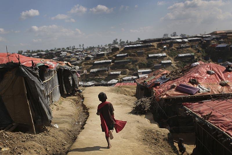 A Rohingya Muslim child runs on a dirt track between tents at Kutupalong refugee camp in Bangladesh, on Sunday, November 19, 2017. Photo: AP