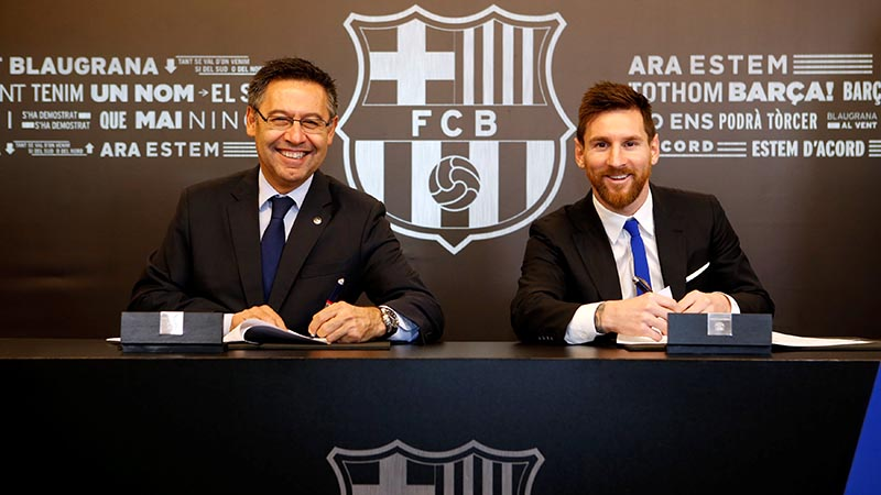 Barcelona's Argentine superstar Lionel Messi poses with FC Barcelona president Josep Maria Bartomeu during the signing of his new contract in Barcelona, Spain, on  November 25, 2017. Photo: German Parga/FC Barcelona/Handout via Reuters