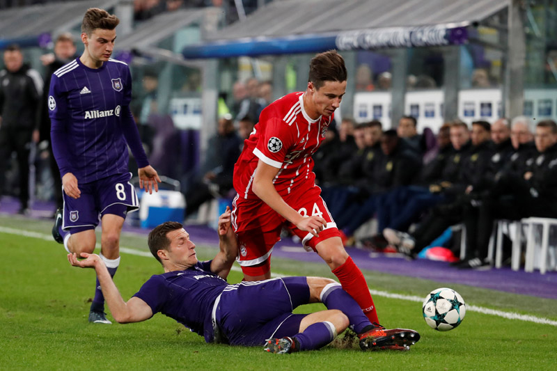 Bayern Munich's Marco Friedl in action with Anderlecht's Uros Spajic. Photo: Reuters