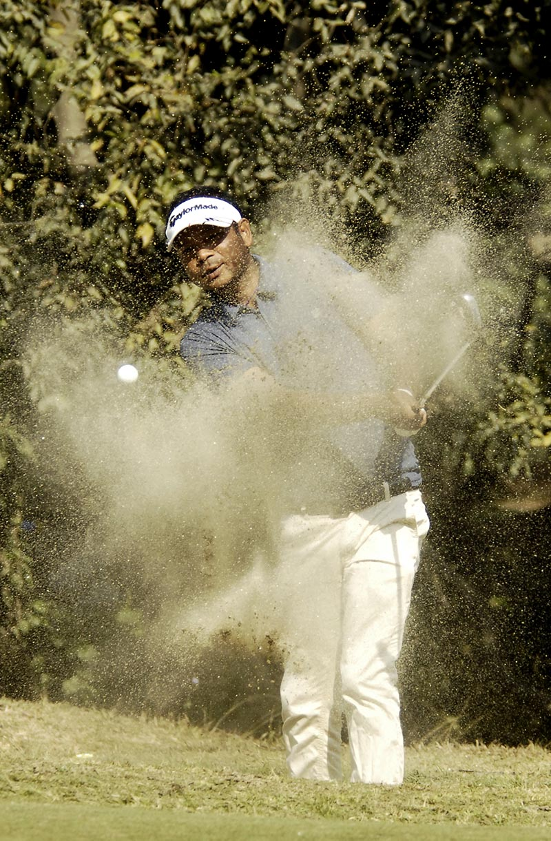Bhuwan Nagarkoti hits a shot from bunker during the third round of the Surya Nepal Challenge at the Royal Nepal Golf Club in Kathmandu on Wednesday, November 29, 2017. Photo: THT