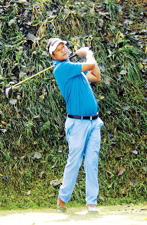 Bhuwan Nagarkoti plays a shot during the first round of the Surya Nepal Challenge at the Royal Nepal Golf Club in Kathmandu on Monday. Photo: Naresh Shrestha / THT