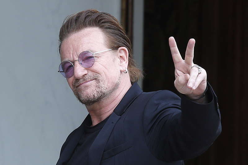 FILE - In this July 24, 2017, file photo, U2 singer Bono makes a peace sign as he arrives for a meeting at the Elysee Palace, in Paris, France. Photo: AP