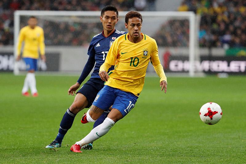 Brazilu2019s Neymar in action with Japanu2019s Makoto Hasebe. Photo: Reuters