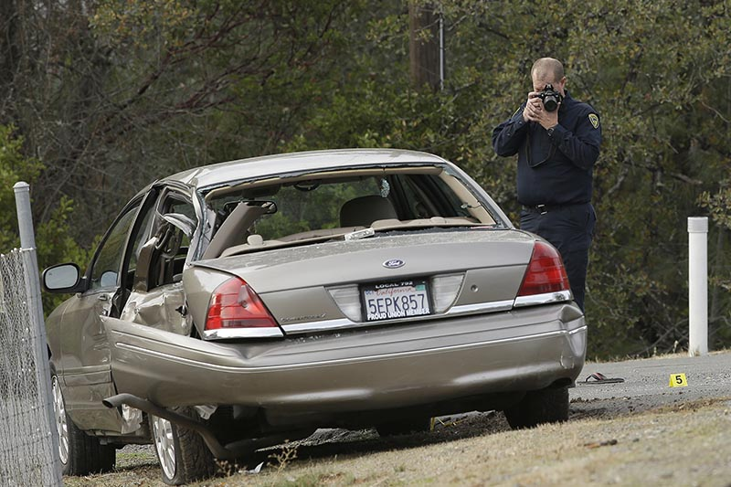 A California Highway patrol officer photographs a vehicle involved in a deadly shooting rampage at the Rancho Tehama Reserve, near Corning, California, on Tuesday, November 14, 2017. Photo: AP