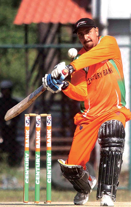 A player of Century Bank bats against Machhapuchchhre Bank during their Century Bank Corporate Super Sixes match at the TU Stadium in Kirtipur on Tuesday. Photo: THT
