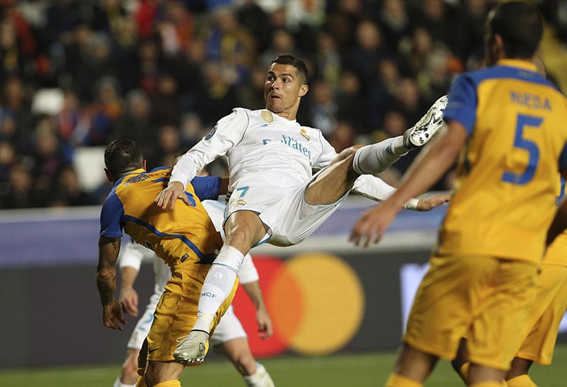 Real Madrid's Cristiano Ronaldo scores the fifth goal of his team during the Champions League Group H soccer match between APOEL Nicosia and Real Madrid at GSP stadium, in Nicosia, on Tuesday, Nov. 21, 2017. (AP Photo/Petros Karadjias)