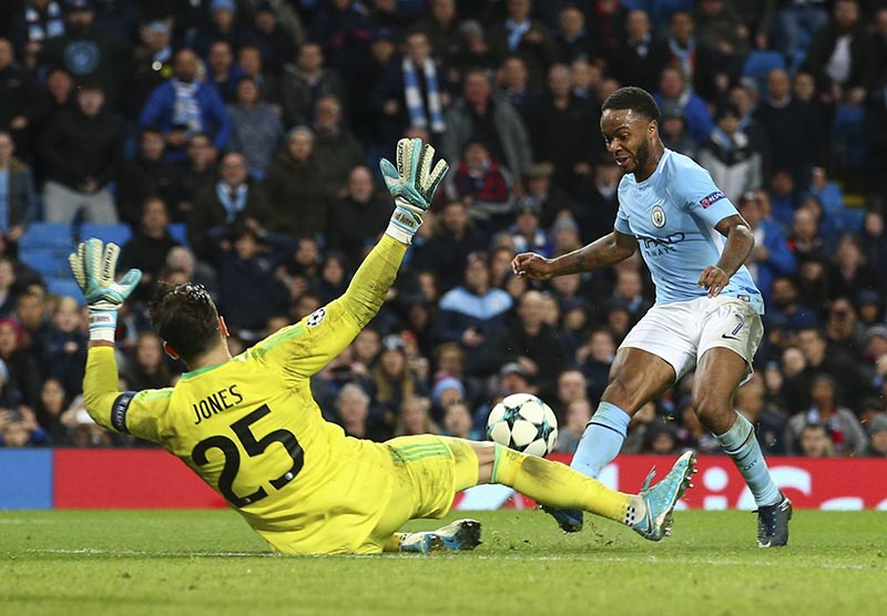 Manchester City's Raheem Sterling scores past Feyenoord goalkeeper Bradley Jones during the Champions League group F soccer match between Manchester City and Feyenoord, at the Etihad Stadium in Manchester, England, on Tuesday, November 21, 2017. Photo: AP