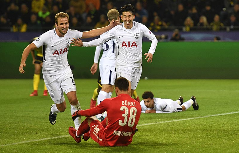 Tottenham's Son Heung-min, (right), celebrates after scoring his side's second goal during the soccer Champions League group H match between Borussia Dortmund and Tottenham Hotspur in Dortmund, Germany, on Tuesday, November 21, 2017. Photo: AP