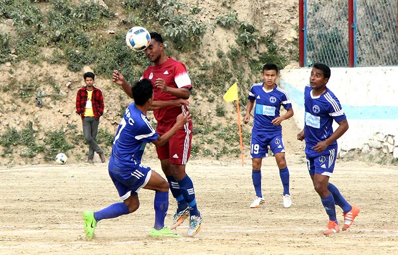 Players of NPC and CMG Club Sankata (centre) vie for the ball during their Chandragiri Gold Cup match. Photo: THT