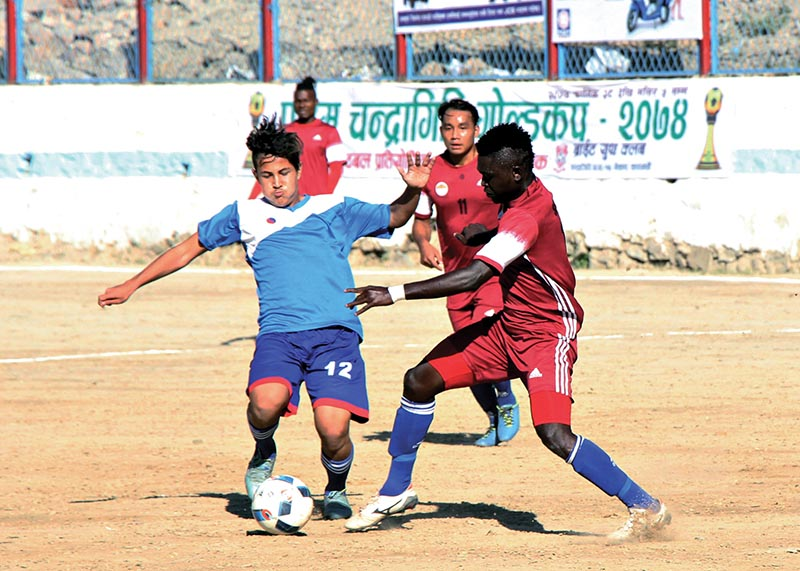Players of NIBL  Friends Club and CMG Club Sankata (right) vie for the ball during their Chandragiri Gold Cup match at the Naikap grounds in Kathmandu on Saturday. Photo: THT