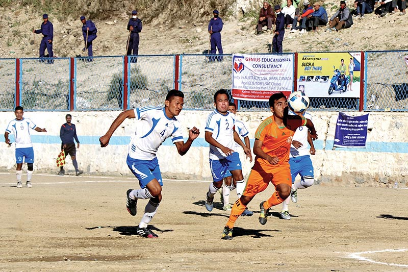 Players of Tribhuvan Army Club and Himalayan Sherpa Club (right) vie for the ball during their Chandragiri Gold Cup match at the Naikap grounds on Sunday. Photo: THT