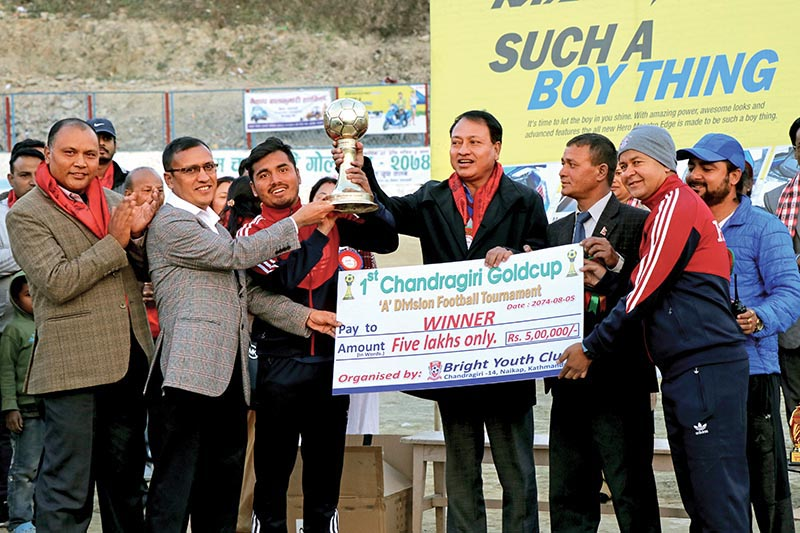 Himalayan Sherpa Club team members receiving trophy from NSC Member Secretary Keshab Kumar Bista (centre)after the Chandragiri Gold Cup Football Tournament. Photo: THT