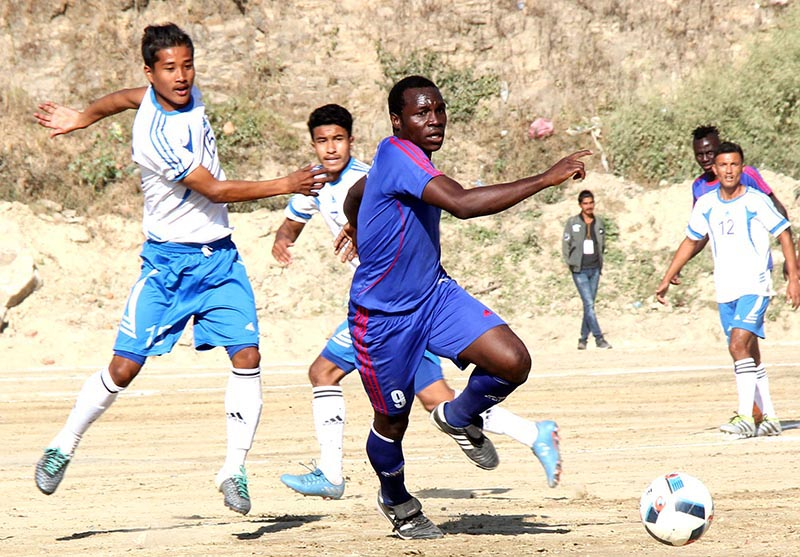 Players of Tribhuvan Army Club (left) and Jawalakhel Youth Club vie for the ball during their first Chandragiri Gold Cup match in Kathmandu on Wednesday, November 15, 2017. Photo: THT