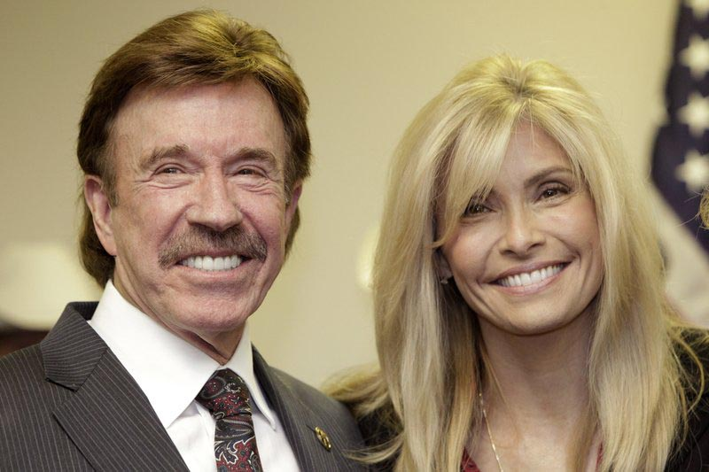 FILE - In this Dec. 2, 2010 file photo, actor Chuck Norris, left, and his wife Gena pose for a photo following a ceremony in Garland, Texas. Photo: AP