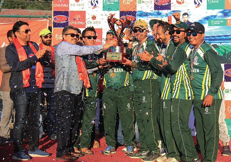 Civil Bank team members celebrate with officials after winning the Century Bank Corporate Super Sixes in Kathmandu on Saturday. Photo: THT
