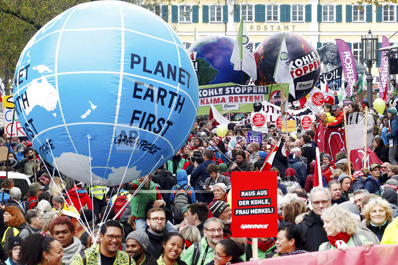 Protestors demand the implementation of the climate change convention in Bonn, Germany, Saturday, Nov. 4, 2017.  The Climate summit starts Monday Nov. 6, in Bonn. Photo: AP