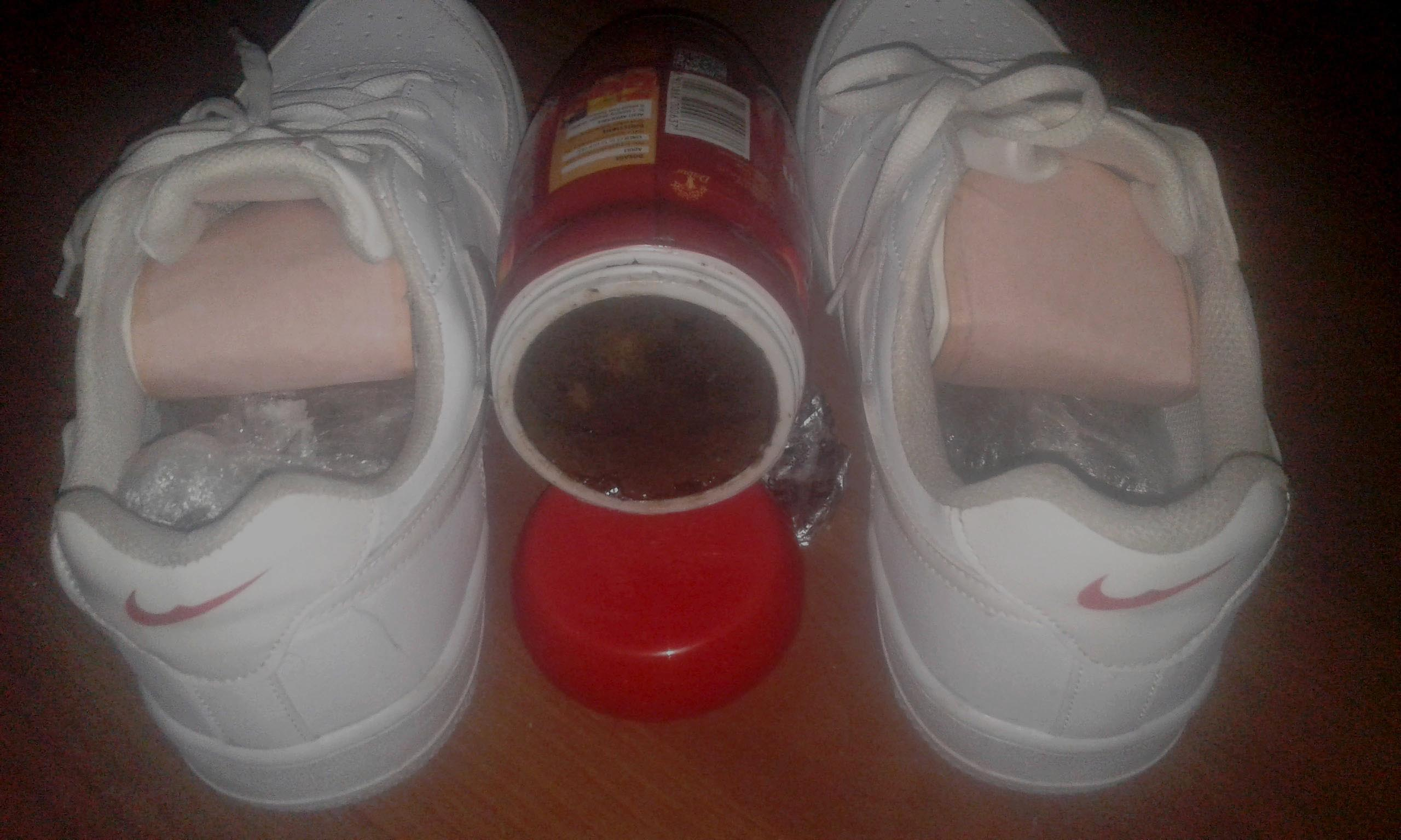 This image displays hashish hidden in a pair of 'Stylish' brand sneakers and other portion of the drug filled in a jar of Dabur Chyawanprash, an ayurvedic medicine, in Kathmandu, on Tuesday, November 8, 2017. A Ukrainian national Oleksii Lolenko (42) was arrested in possession of the drug from Tribhuvan International Airport on Tuesday. Photo: NCB Nepal