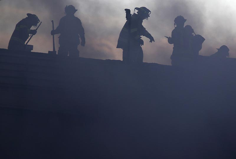 Firefighters work at the scene of a factory fire in New Windsor, New York,  on Monday, November 20, 2017. Photo: AP
