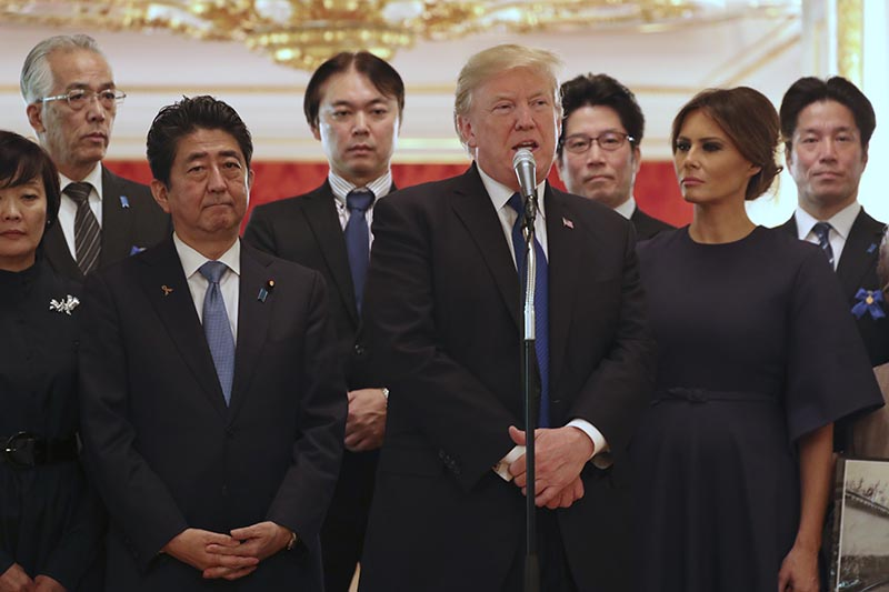 President Donald Trump (centre), speaks as Trump and first lady Melania Trump (right),  meet with the families of Japanese abducted by North Korea at the Akasaka Palace, in Tokyo, on Monday, November 6, 2017. Photo: AP