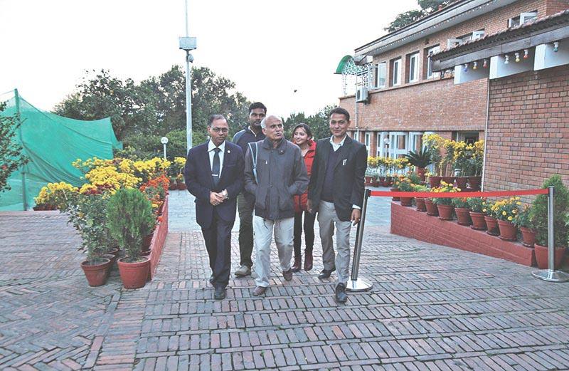 Dr Govinda KC and his team members emerging from the prime ministeru2019s official residence, in Kathmandu, on Thursday, November 9, 2017. Photo: RSS