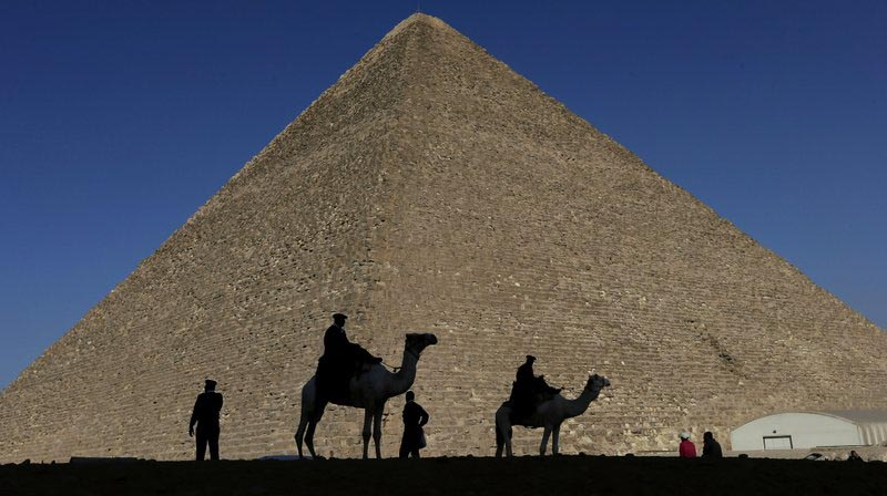 Policemen are silhouetted against the Great Pyramid in Giza, Egypt, on December 12, 2012. Photo: AP/ File