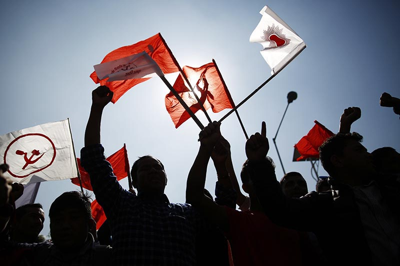 Activists holding flags of their parties while taking part in rallies accompanying leaders to file nomination papers for the second phase of parliamentary and provincial polls, in Kathmandu, on Thursday, November 2, 2017. Photo: Skanda Gautam/THT