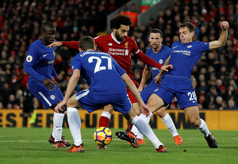 Liverpool's Mohamed Salah in action with Chelsea's Cesar Azpilicueta, Andreas Christensen and N'Golo Kante during the Premier League match between Liverpool and Chelsea, in Anfield, Liverpool, Britain, on November 25, 2017. Photo: Reuters