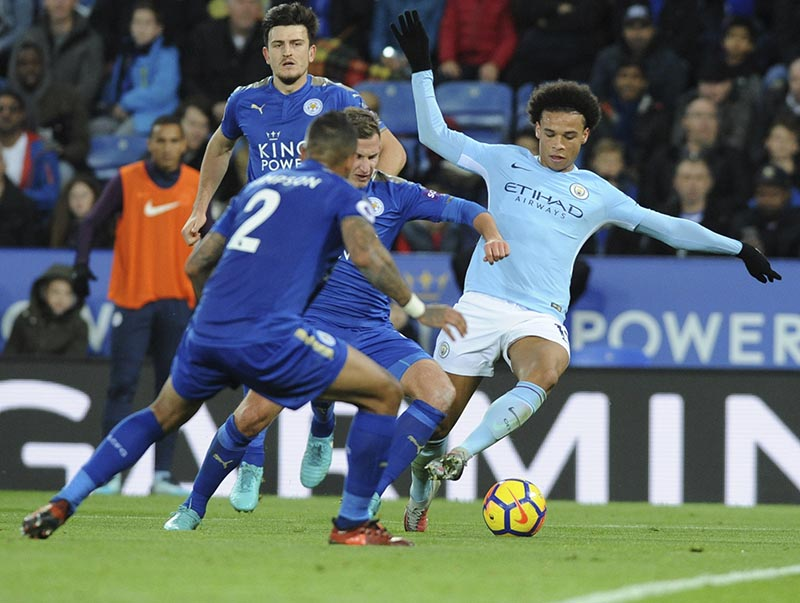 Manchester City's Leroy Sane (right), battles for the ball with Leicester's Danny Simpson (left), and Leicester's Marc Albrighton (centre), during the English Premier League soccer match between Leicester City and Manchester City at the King Power Stadium in Leicester, England, on Saturday, November 18, 2017. Photo: AP