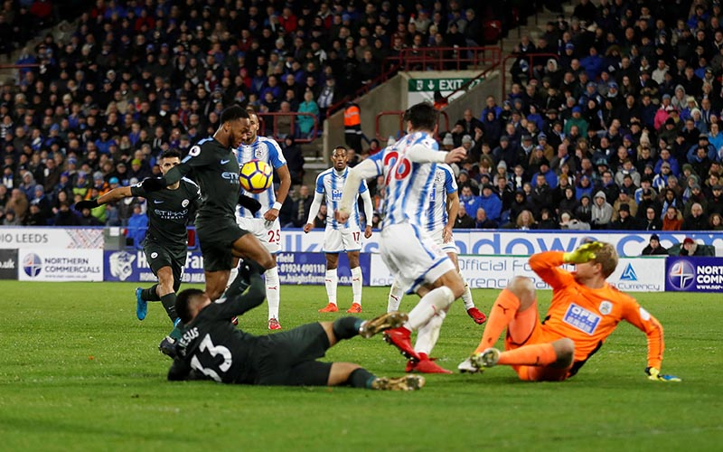Manchester City's Raheem Sterling scores their second goal during the Pemier League match between Huddersfield Town and Manchester City, at John Smith's Stadium, in Huddersfield, Britain, on November 26, 2017. Photo: Action Images via Reuters