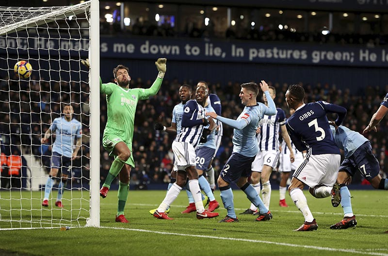 Newcastle United's Ciaran Clark (centre), scores his side's first goal against West Bromwich Albion during the English Premier League soccer match at The Hawthorns, in West Bromwich, England, on Tuesday November 28, 2017. Photo: David Davies/PA via AP