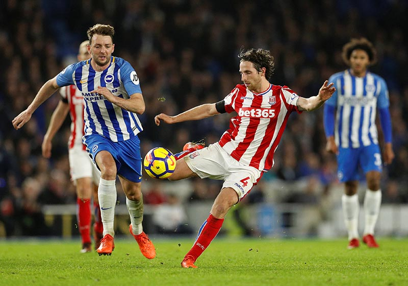 Stoke City's Joe Allen in action with Brighton's Dale Stephens during the Premier League match between Brighton & Hove Albion and Stoke City, at The American Express Community Stadium, in Brighton, Britain, on November 20, 2017. Photo: Action Images via Reuters