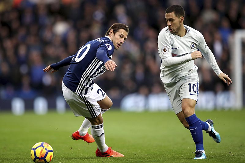 West Bromwich Albion's Grzegorz Krychowiak (left), and Chelsea's Eden Hazard battle for the ball during the English Premier League soccer match at The Hawthorns, West Bromwich, England,u00a0on Saturday November 18, 2017. Photo: Nick Potts/PA via AP
