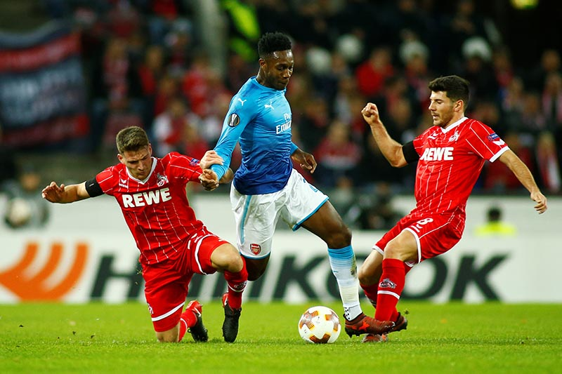 Arsenal's Danny Welbeck in action with Cologne's Salih Ozcan and Milos Jojic (right) during the Europa League match between  FC Cologne and Arsenal , at RheinEnergieStadion, in Cologne, Germany, on  November 23, 2017. Photo: Reuters
