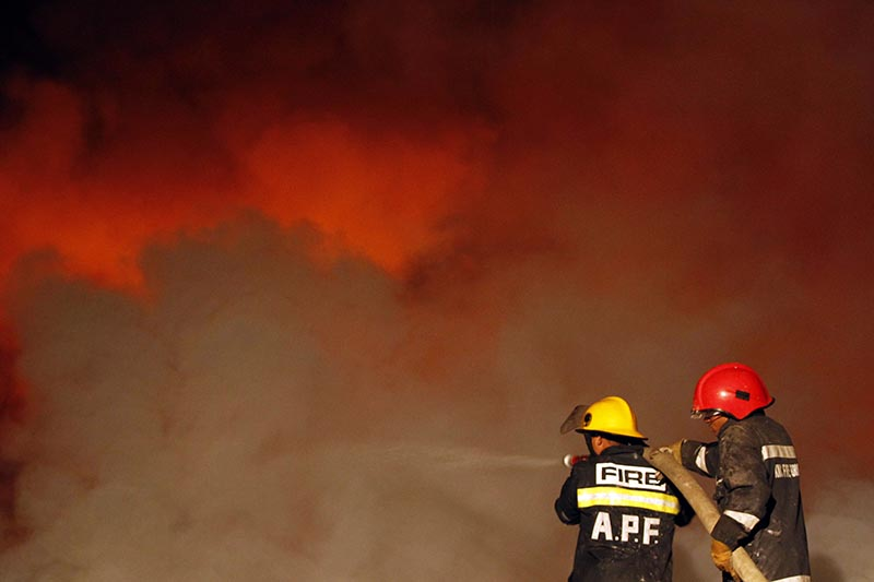 Firefighters work to extinguish a fire at Patan Industrial Estate in Lalitpur, Nepal, on Tuesday, November 14, 2017. Photo: AP