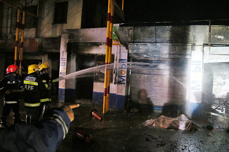 Fire fighters trying to douse the inferno at a motorbike garage nearJayanti Oil Store in Tripureshwor, Kathmandu, on Thursday, November 09, 2017. Photo: RSS