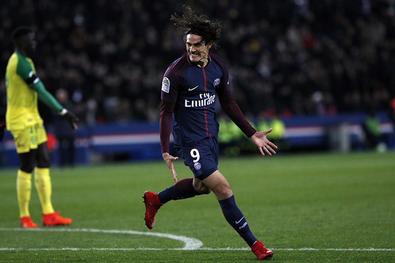 PSG's Edinson Cavani celebrates after he scored a goal during his French League One soccer match between Paris-Saint-Germain and Nantes, at the Parc des Princes stadium in Paris, France, on Saturday, November18, 2017. Photo: AP