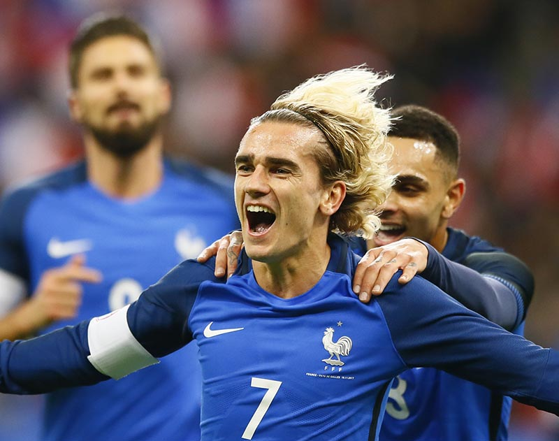 France's Antoine Griezmann celebrates after scoring his side's opening goal during an international friendly soccer match between France and Wales at Stade de France in Saint Denis, a northern suburb of Paris, France, on Friday, November 10, 2017. Photo: AP