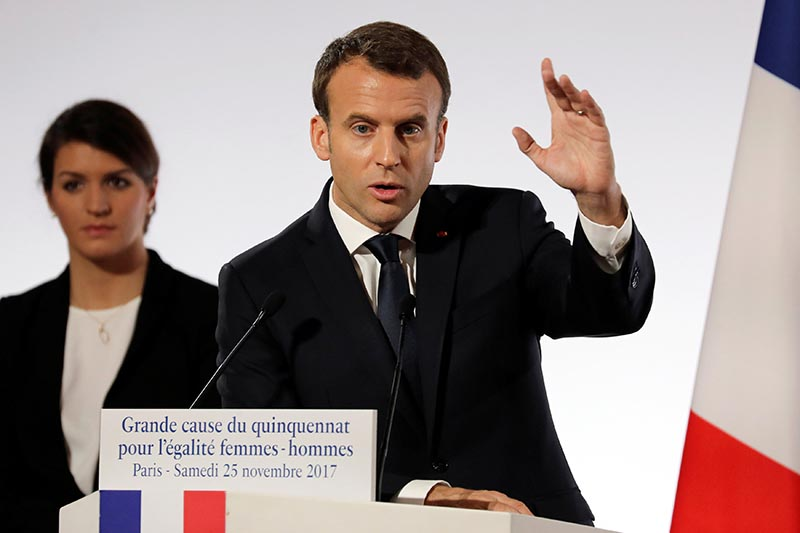 French President Emmanuel Macron stands in front of French Junior Minister for Gender Equality Marlene Schiappa as he delivers a speech during the International Day for the Elimination of Violence Against Women, at the Elysee Palace in Paris, France, on November 25, 2017. Photo: Reuters