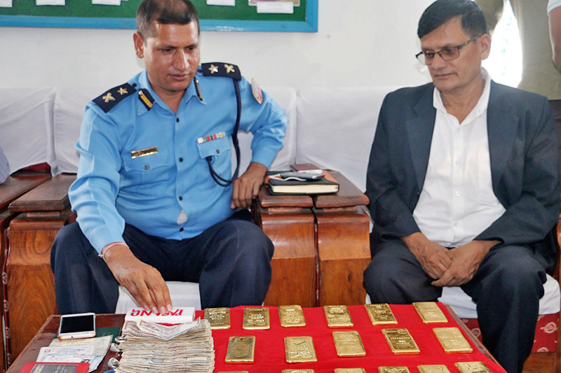 Police displaying seized gold along with other items at the District Police Office Lamjung, on Thursday, November 02, 2017. Photo: Ramji Rana