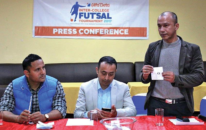 Ex-football skipper Hari Khadka holds a draw as Olympian Deepak Bista (left) and Acting President of Alfa Beta Dweeraj Sharma look on during a press meet in Kathmandu. Photo: THT