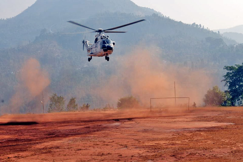 A helicopter, carrying ballot boxes after first phase of House of Representatives and State Assemblies elections at a remote villages, prepareing to land at Dhadingbesi, district headquarters of Dhading, on Monday, November 27, 2017. Photo: Keshav Adhikari