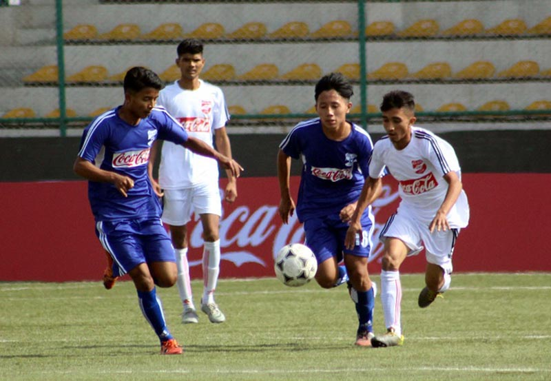 Players of Mahendra Memorial and Sainik Awashiya Mahavidhyalaya (right) in action during their Coca-Cola Inter-school Football Tournament match in Lalitpur, on Wednesday, November 15, 2017. Photo: THT