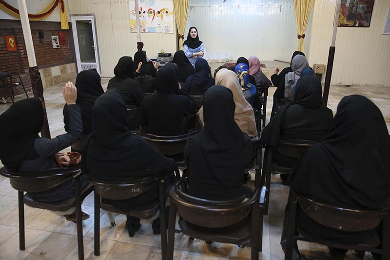 Psychologist Najimeh Babagol speaks in a class with HIV-positive women at Reviving Values aid group institute in Tehran, Iran, on Wednesday, September 27, 2017. Photo: AP